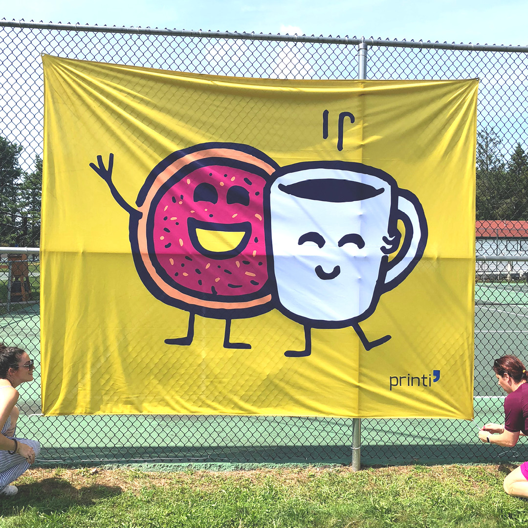 smiling mug and donut on a large flag